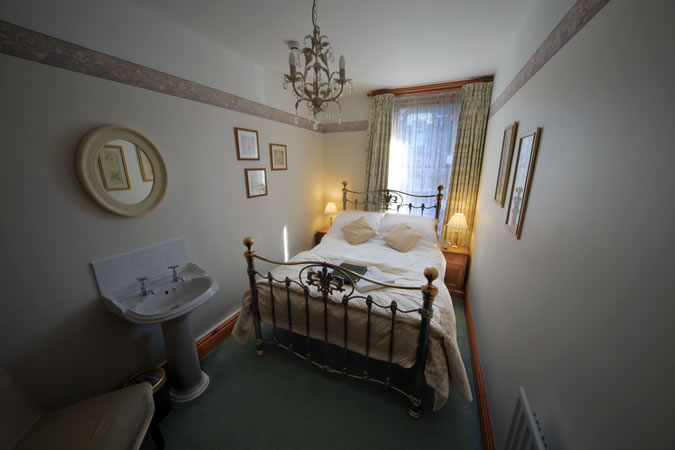 Our new bed in the double room that has private use of a luxury bathroom.