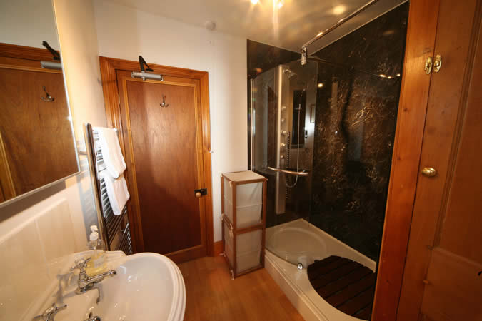 Now this is a luxury bathroom - with walk in shower and vertical shower tower.