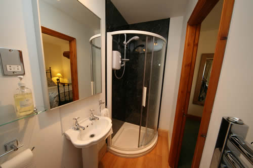 With a well equipped en suite bathroom